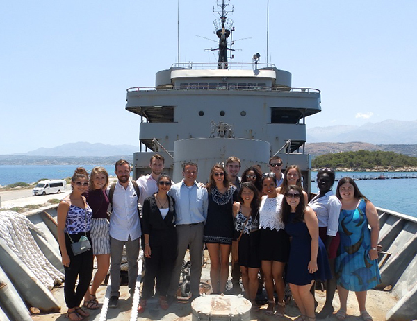 Students and faculty aboard a naval ship in Crete, Greece, as part of a travel course