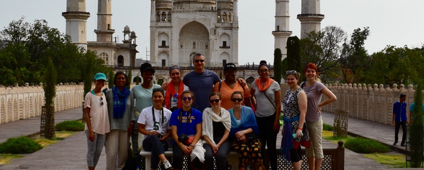 Students and faculty standing in front of the Taj Mahal during a travel course to India